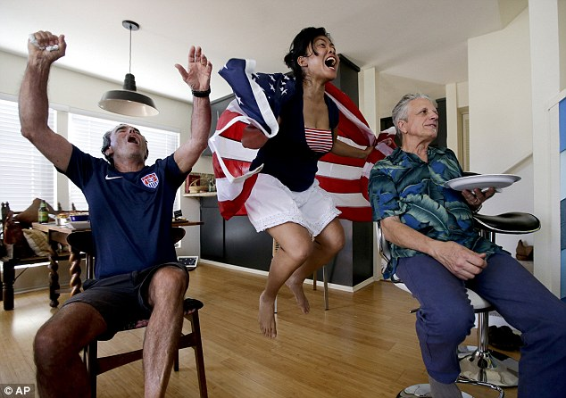Soccer fans in Newport Beach, California, react after Portugal scored against the USA in the first half of the June 22 match