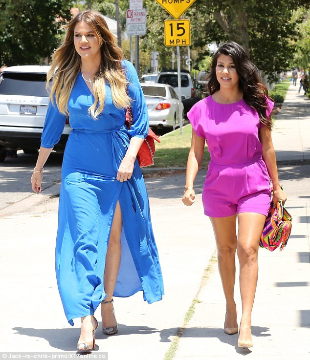Summer style: Kourtney wore a bright pink playsuit as she headed to lunch with hr sister Khloe to film a scene for their reality show