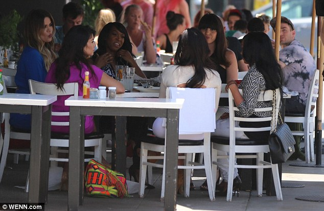 Center of attention: All eyes were on Kim Kardashian as she enjoyed a lunch with sisters Kourtney and Khloe and some gal pals