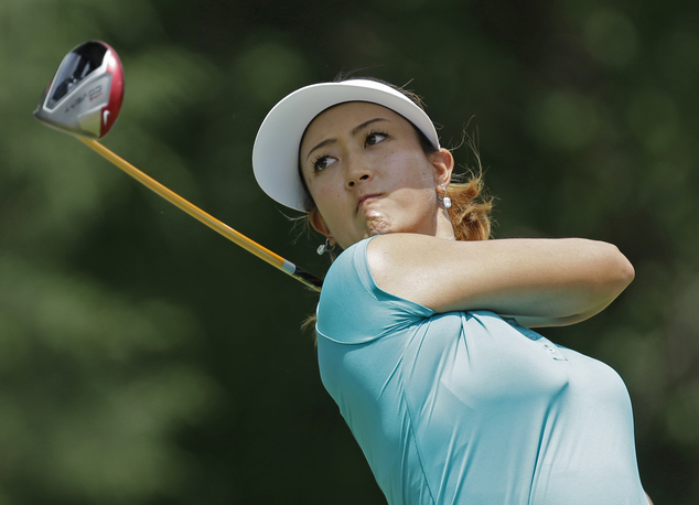 Michelle Wie watches her tee shot on the seventh hole during the final round of the U.S. Women's Open golf tournament in Pinehurst, N.C., Sunday, June 22, 20...