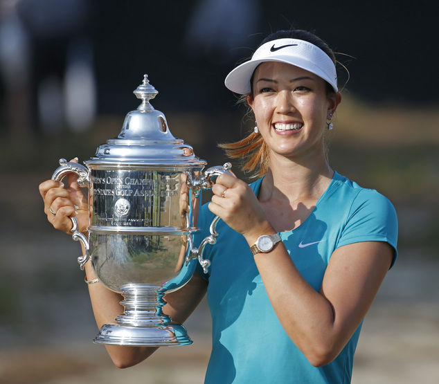 Michelle Wie poses with the trophy after winning the U.S. Women's Open golf tournament in Pinehurst, N.C., Sunday, June 22, 2014. (AP Photo/John Bazemore)