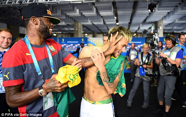 All smiles: Song playfully shoves the Brazilian superstar in the face in the tunnel after their Group A clash