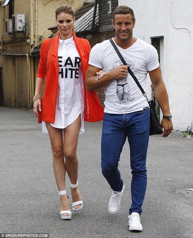 Getting shirty: Chloe appeared to have forgotten her trousers as she walked to her salon in a thigh skimming shirt dress with romance Elliot Wright