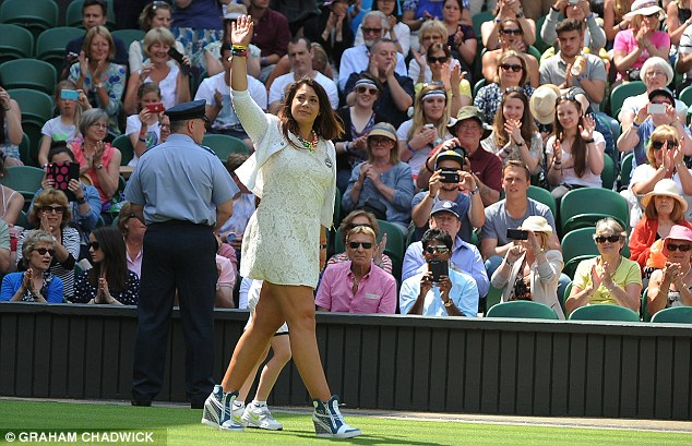 Emotional: Marion Bartoli sheds a tear as she returns to the scene of her victory in 2013