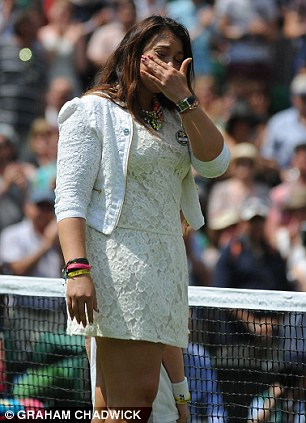 Marion Bartoli sheds a tear as she returns to the scene of her victory in 2013