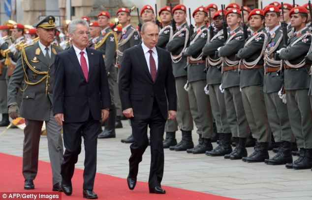 Putin, right, spent today discussing the conflict with his Austrian counterpart Heinz Fischer, left, in Vienna