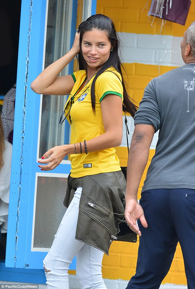 Strike a pose: Adriana watched the game at a bar on the Lower East Side in New York City