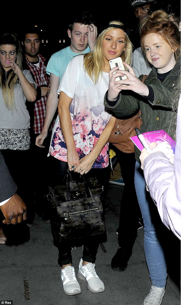 So popular: Ellie was mobbed by fans as she made her way into the venue