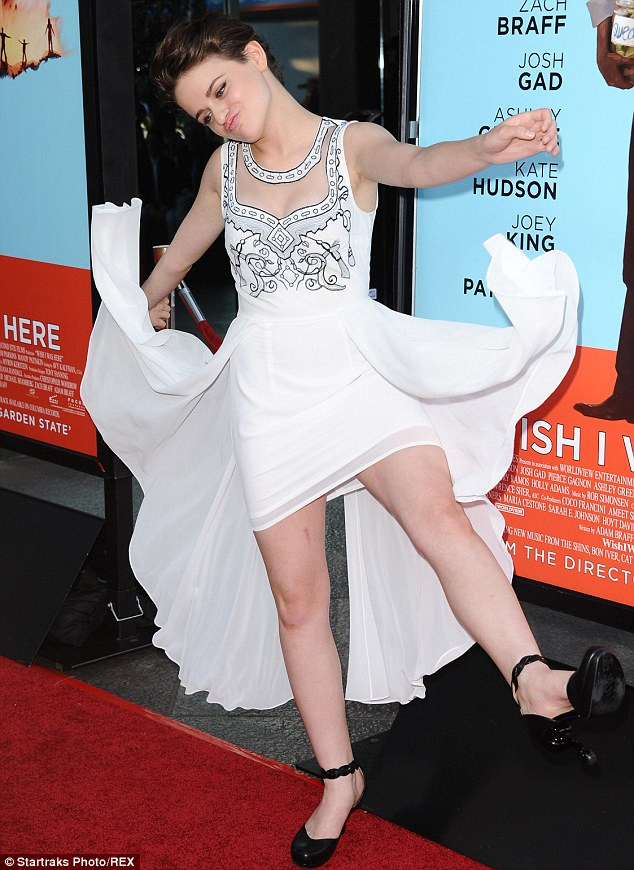 Excitable: Joey threw out the floaty side panels on her dress while dancing on the red carpet