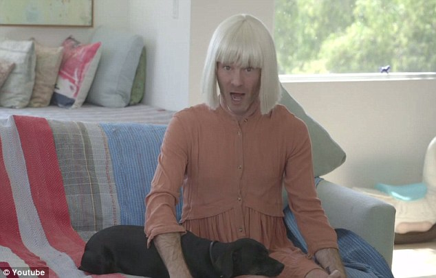 Seeing double: Sia's video acceptance speech was made for her by a man in a wig miming on a couch