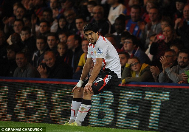 Heartache: Suarez sits in disbelief after Liverpool throw away a three-goal lead against Crystal Palace