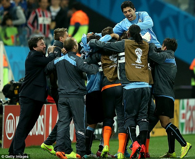 Bundle: His brace kept Uruguay in with a chance of qualifying from Group D