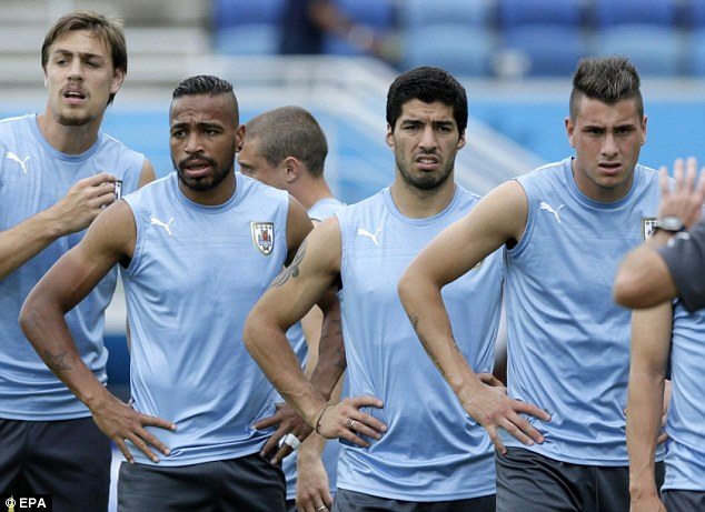 Puffed out: Suarez and his team-mates looking tired at the end of a session