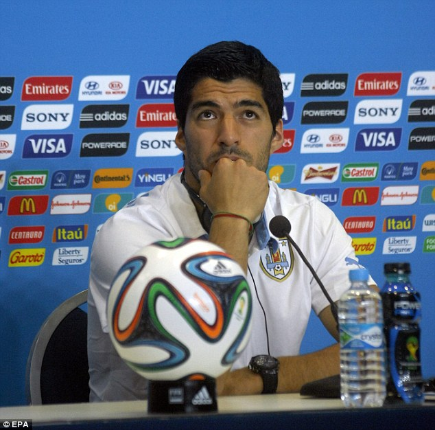 Gearing up: Suarez in a press conference before the vital Group D showdown