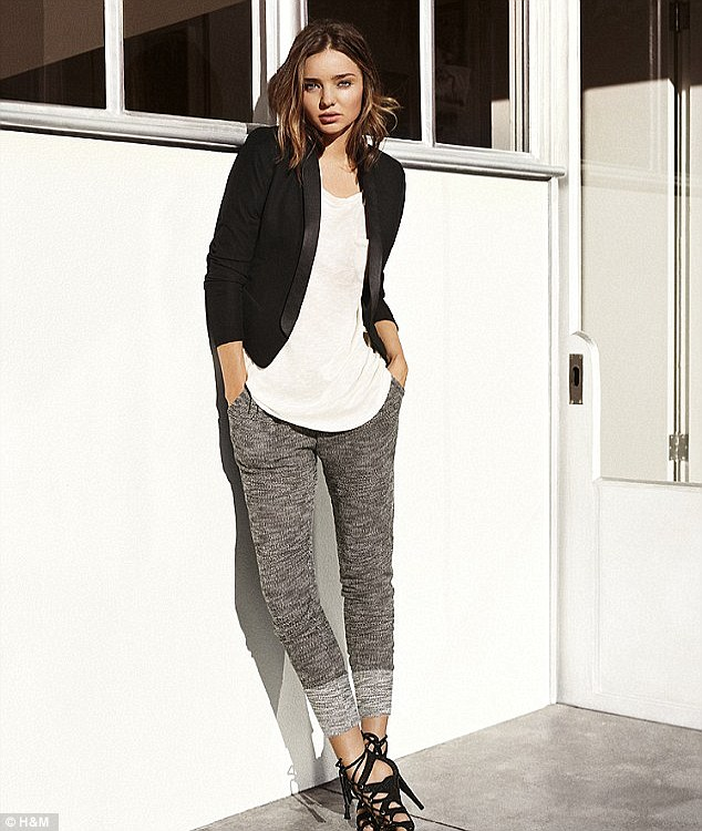 Smartening up: Miranda Kerr rocked elasticated waistband joggers in her H&M campaign but added heels and a blazer to take her look from day to night