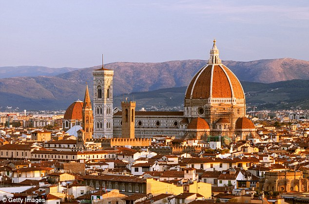 Sunshine at work: The fabled orange rooftops of Florence look even more glorious in summer