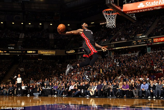 Happier times: James dunks the ball during Miami Heat's win over Sacramento Kings in December