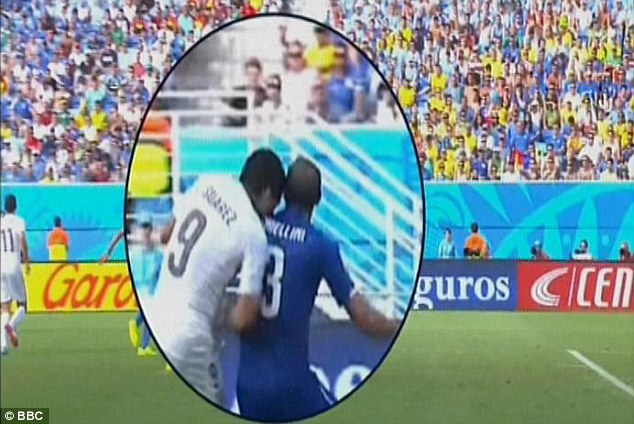 Shocking: Luis Suarez appeared to bite Girogio Chiellini's shoulder during Uruguay's win over Italy on Wednesday at the FIFA World Cup in Brazil