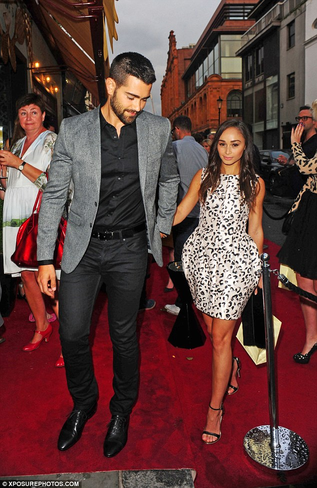 True gent: Metcalfe held his girlfriend's hand as they made their way into the venue