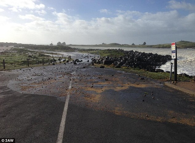 Port Fairy in south-west Victoria saw huge waves which carried rocks on to nearby roads