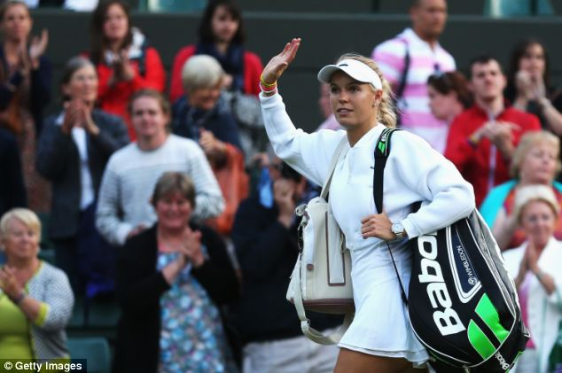 Doppelganger: Miss Broady and Miss Wozniacki, 23, (pictured) looked near-identical on the court yesterday with matching long blonde plaits, white sun visors and gold necklaces
