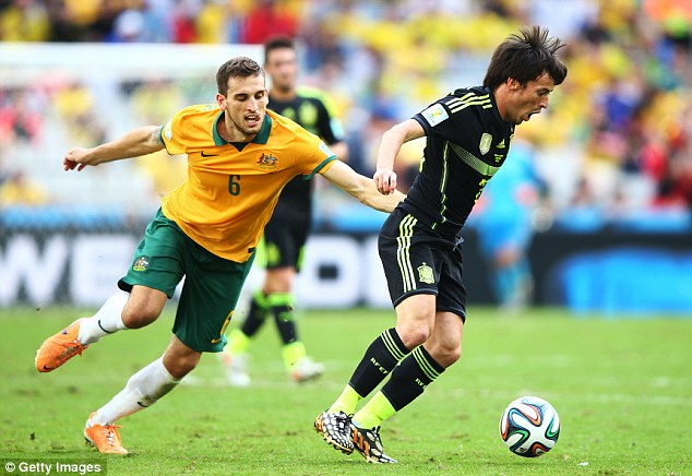 Dispute: The commentators fell out after the Australia v Spain game during the 2014 FIFA World Cup in Brazil on Tuesday. In this picture David Silva of Spain controls the ball against Matthew Spiranovic of Australia