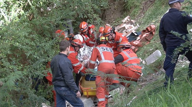 A man was airlifted to hospital after a 10 metre brick wall fell on him in Mittagong, NSW