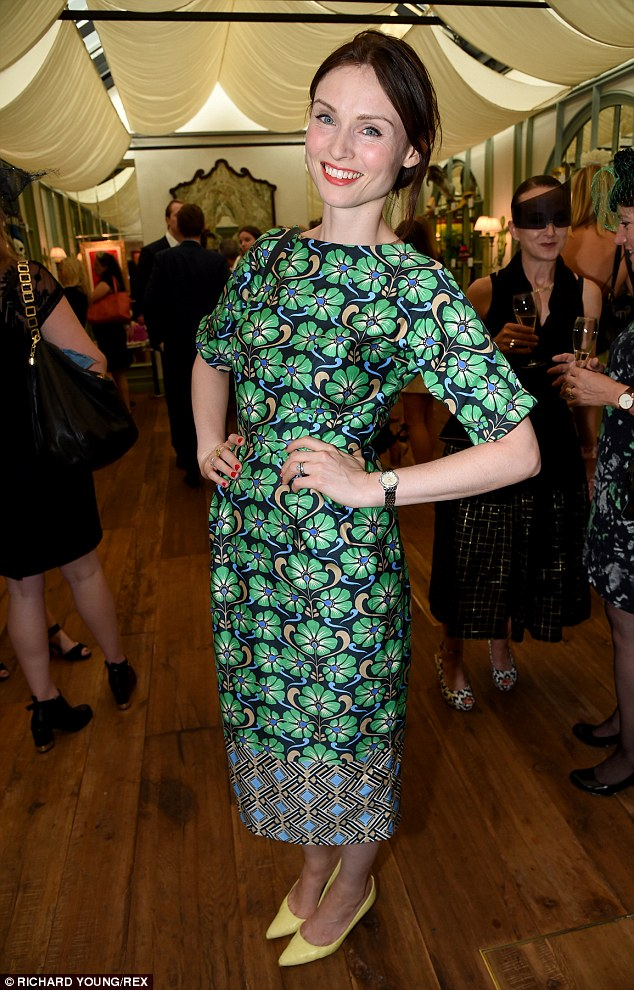 Clothes horse: The pop star contrasted her dress with a pair of yellow court shoes