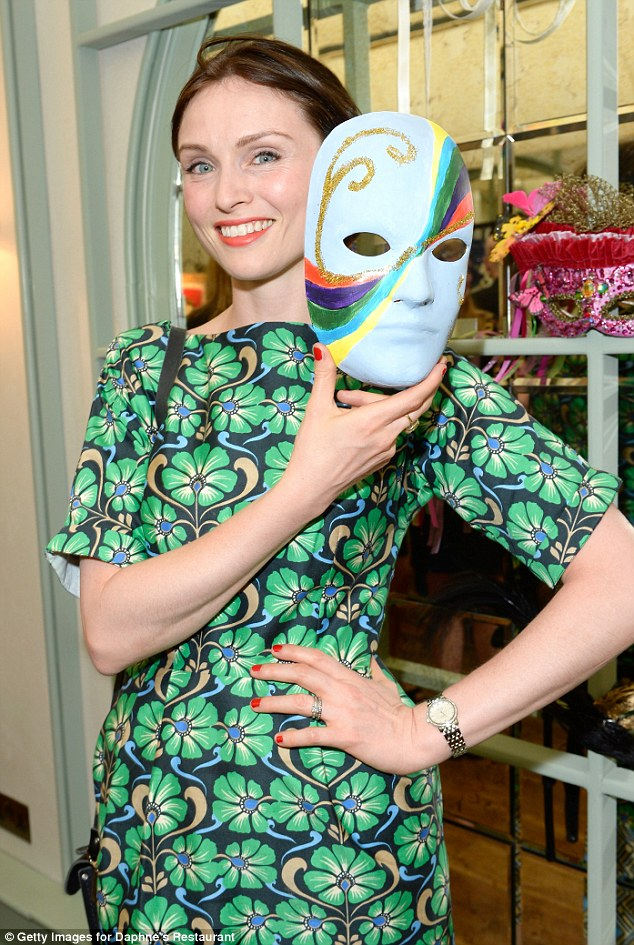 Supportive: Sophie poses with her Venetian mask which was made to honour Daphne¿s Italian heritage