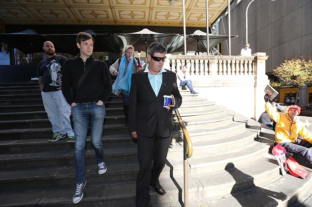 21st century crime: Peter Lewis Sheather (pictured leaving Downing Centre Court after pleading guilty to nine 'sexting' charges) will receive psychological counselling before his sentencing in August. He harassed women pool owners in Sydney's eastern suburbs and upper north shore with lurid messages and images