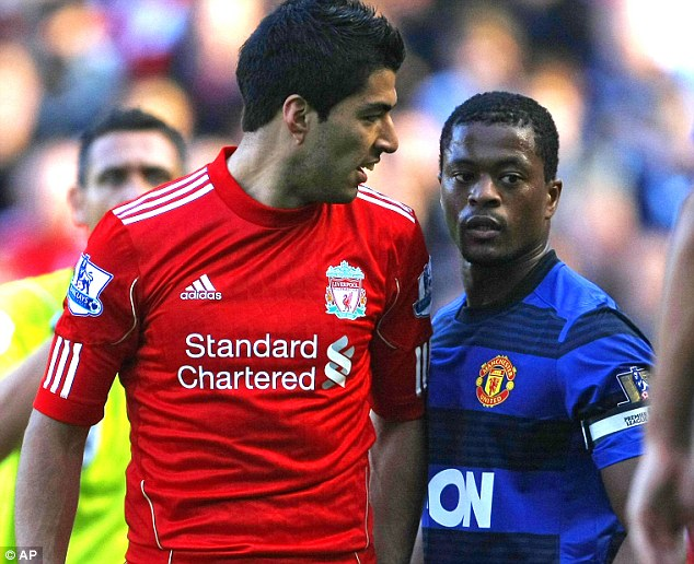 Confrontation: Suarez was found guilty of racially abusing Patrice Evra in 2011