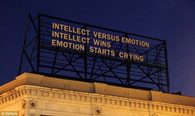 Getting emotional: This billboard imagines a fight between intellect and emotion - with a clear winner