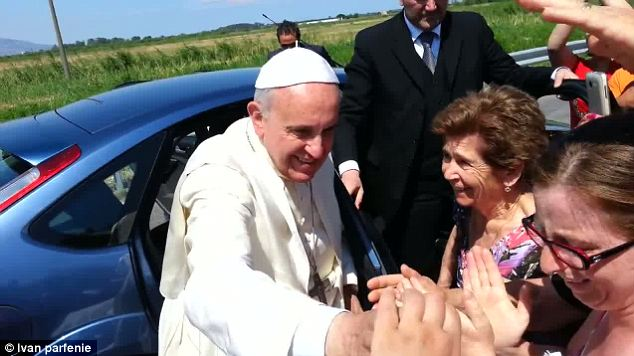 Loved: Francis greets relatives of the woman after stepping out of his car for the impromptu and unplanned stop