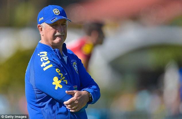 So far, so good: Brazil coach Luiz Felipe Scolari keeps watch over the session