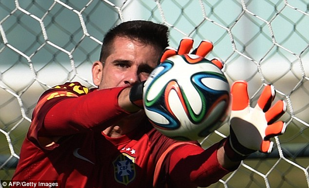 Safe hands: Julio Cesar gets his palms behind the ball as the goalkeepers are peppered with shots