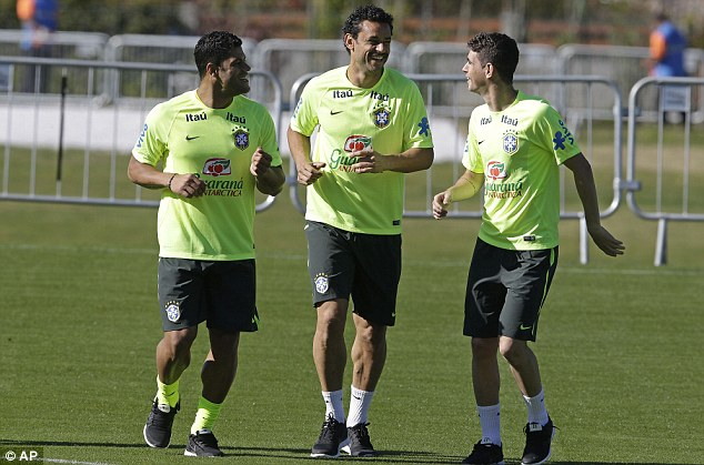 Free spirits: Hulk, Fred and Oscar jog and chat as Brazil get ready for training