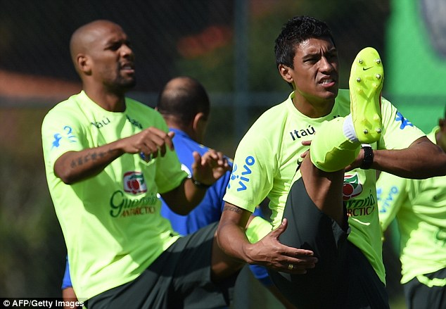 Alive and kicking: Maicon and Paulinho stretch their legs during the warm-up