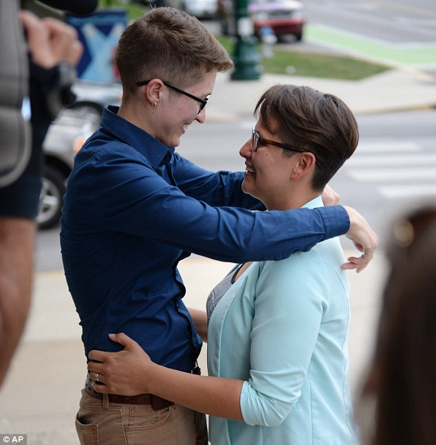 Sarah Perfetti, right, and Abby Henkel, left, are married outside the Monroe County Justice Building on Wednesday in Bloomington, Indiana