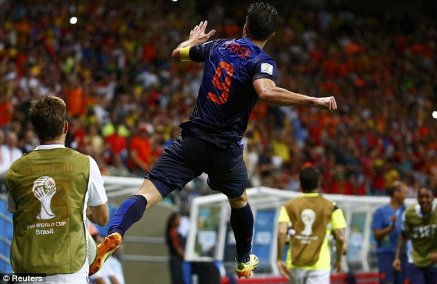 Jumping for joy: Robin van Persie leaps into the air after scoring Holland's fourth in their 4-0 rout of Spain
