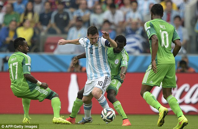 Top form: Lionel Messi struck twice in Argentina's 3-2 win over Nigeria to take his tournament tally to four