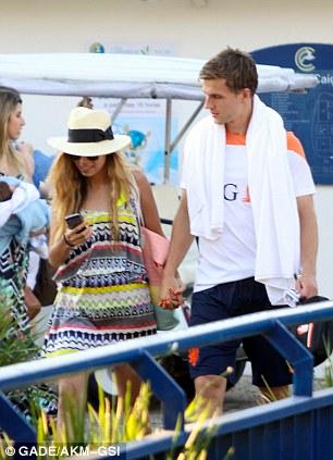 Holding hands: Joel Veltman enjoys the time out