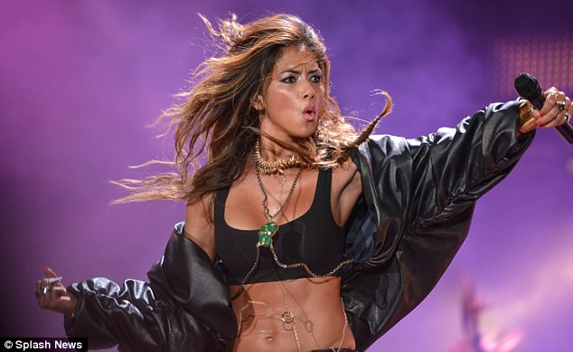 Moves Like Jagger! Nicole appeared to be feeling the heat as she danced on stage in her long-sleeved jacket