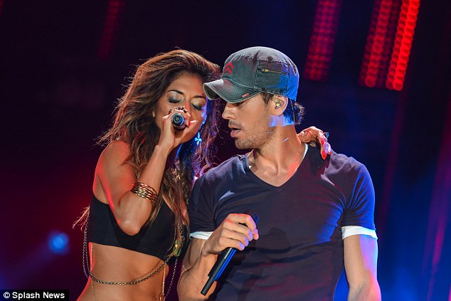 Pals: Meanwhile Enrique looked casual sporting a trademark hat in the form of a denim baseball-style number