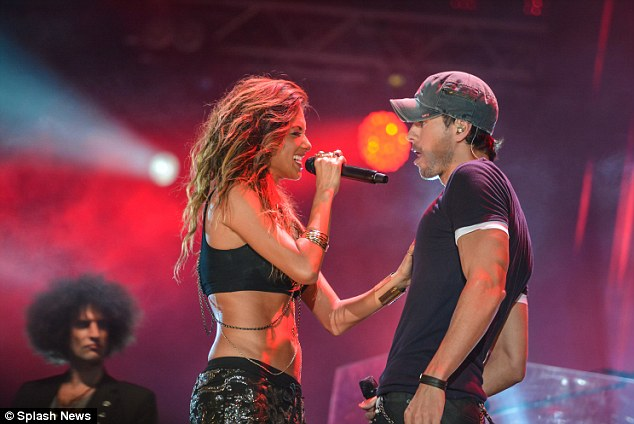 Turning up the heat: Nicole later ditched her voluminous leather jacket as she sang while facing the Hero hitmaker