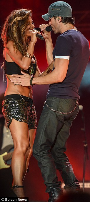 Hot Stuff: The Spanish crooner held onto Nicole's waist as they reunited for a surprise duet of their hit Heartbeat