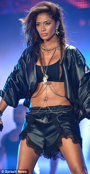 Doll domination: The star put on an energetic performance in her flesh-flashing outfit