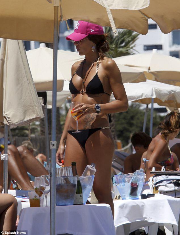 Stunning: Pepe Reina's wife Yolanda Ruiz turned heads as she sunned herself in a black bikini