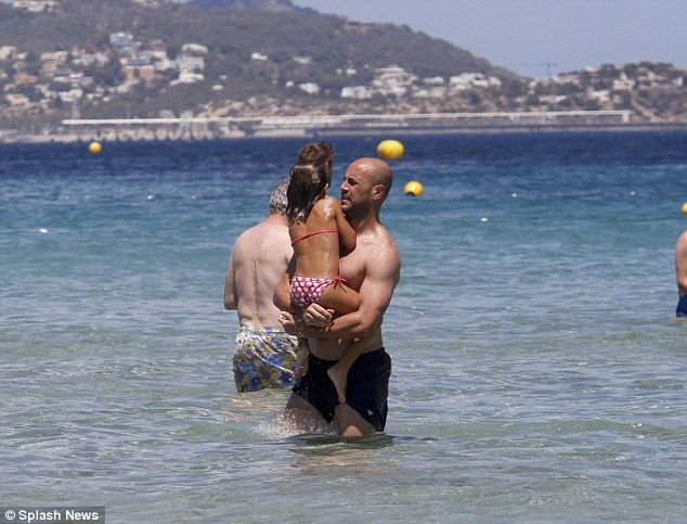 Family vacation: Spanish goalie Pepe Reina enjoys a family holiday to Ibiza after Spain are knocked out of the World Cup