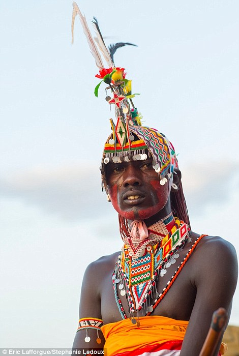 Striking: A Samburu man shows off his elaborate beaded headgear