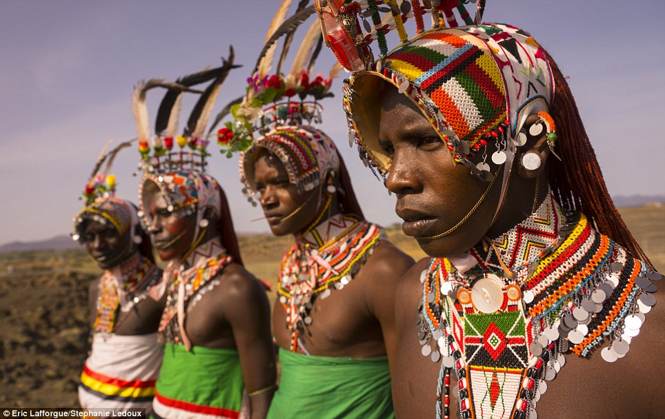 Spectacular: These Samburu men are recently circumcised, a fact made plain by their elaborate feathered headdresses, and cannot spend time with women